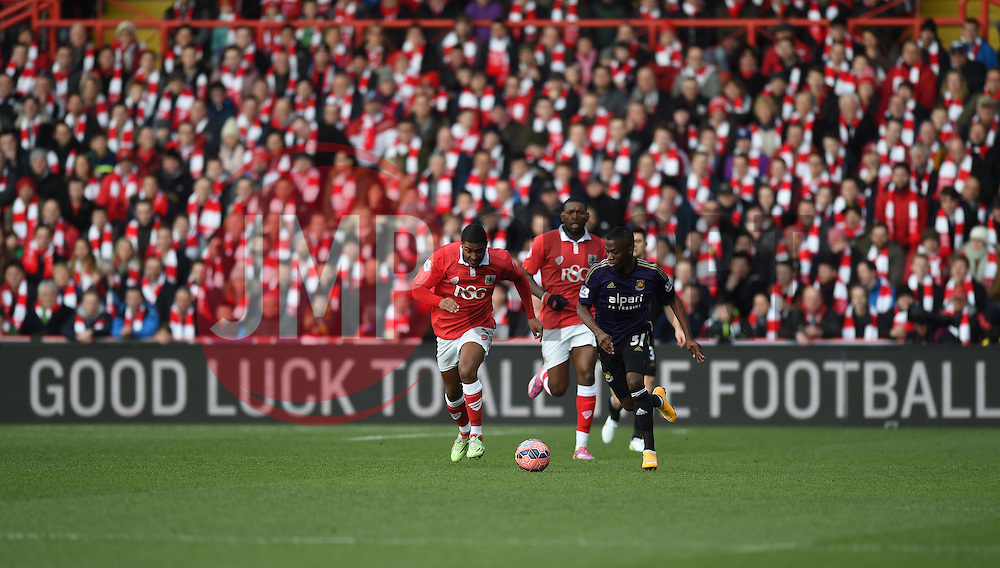 Bristol City's Mark Little and West Ham's Enner Valencia chase the ball - Photo mandatory by-line: Paul Knight/JMP - Mobile: 07966 386802 - 25/01/2015 - SPORT - Football - Bristol - Ashton Gate - Bristol City v West Ham United - FA Cup fourth round