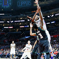 16 December 2015: Los Angeles Clippers center Josh Smith (5) goes for the jump shot over Milwaukee Bucks guard O.J. Mayo (3) during the Los Angeles Clippers 103-90 victory over the Milwaukee Bucks, at the Staples Center, Los Angeles, California, USA.