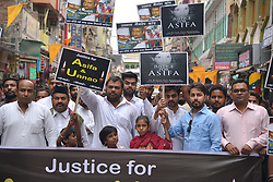 April 13, 2018 - Ajmer, Rajasthan, India - Indian activists and students hold placards and shout slogans during a protest against the alleged political silence over the rape of a child near Jammu and a rape case in Uttar Pradesh state, in Ajmer,rajasthan,india, on April 13, 2018. Indian police on April 12 opened a rape inquiry against a powerful lawmaker from Prime Minister Narendra Modi's ruling party in a case that has cast a new spotlight on impunity enjoyed by the elite. Kuldeep Singh Sengar and his brothers are accused of raping a 16-year-old girl in Unnao district of Uttar Pradesh state, where he is a state lawmaker for the Hindu nationalist Bharatiya Janata Party  (Credit Image: © Shaukat Ahmed/Pacific Press via ZUMA Wire)