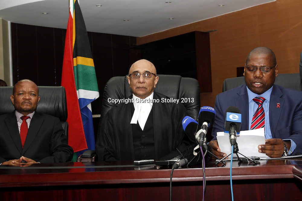 DURBAN - 22 August 2013 - KwaZulu-Natal premier Zweli Mkhize (right) reads a statement announcing that he would be stepping down to become full-time treasurer-general in the ruling African National Congress. The province's education MEC Senzo Mchunu (left) was sworn in by KwaZulu-Natal Judge President Chiman Patel as acting premier. Mkhize has been premier of the province since 2009. Picture: Allied Picture Press/APP