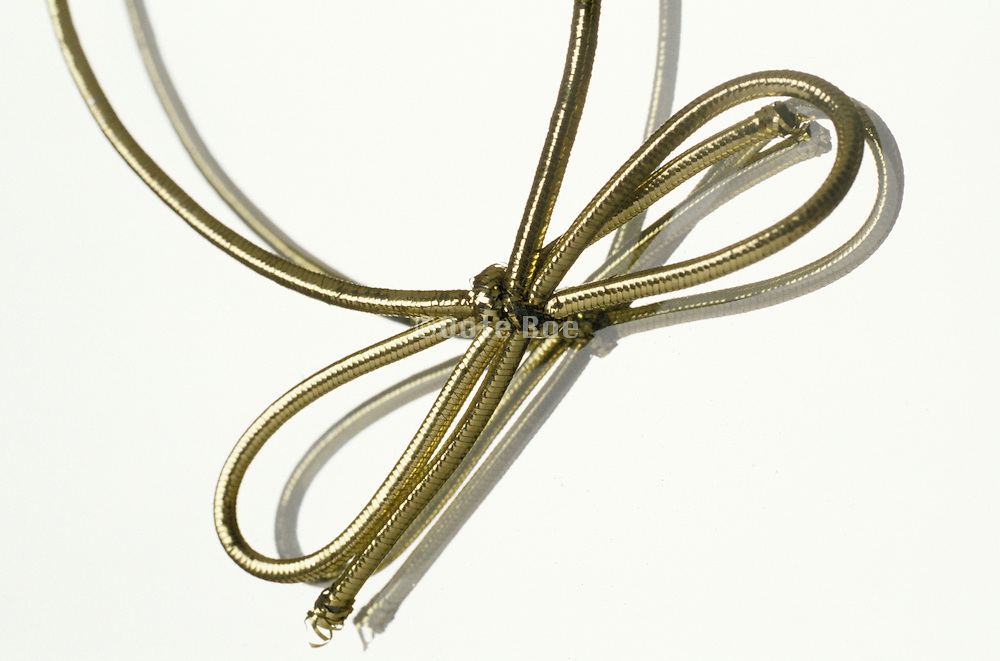 Golden rope in a bow