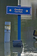 "© Licensed to London News Pictures. 09/01/2014. Marlow, UK. A sign at a car park saying ""Overflow Car Park"" stands in floodwater. Rising river levels in the River Thames at Marlow in Buckinghamshire have led to flooding and property damage along the river today 9th January 2014. Large areas of Britain are experiencing flooding after wet weather. Photo credit : Stephen Simpson/LNP"