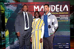 """Zwelivelile Mandela and Raabia Clarke attend the opening event of """"'Mandela: The Official Exhibition' at the Bikini Berlin Mall in Berlin, 18.10.2019. 18 Oct 2019 Pictured: Zwelivelile Mandela, his wife Raabia Clarke and German TV host Patrice Bouedibela attend the opening event of """"Mandela: The Official Exhibition' at the Bikini Berlin Mall in Berlin, 18.10.2019. Photo credit: MEGA TheMegaAgency.com +1 888 505 6342"""