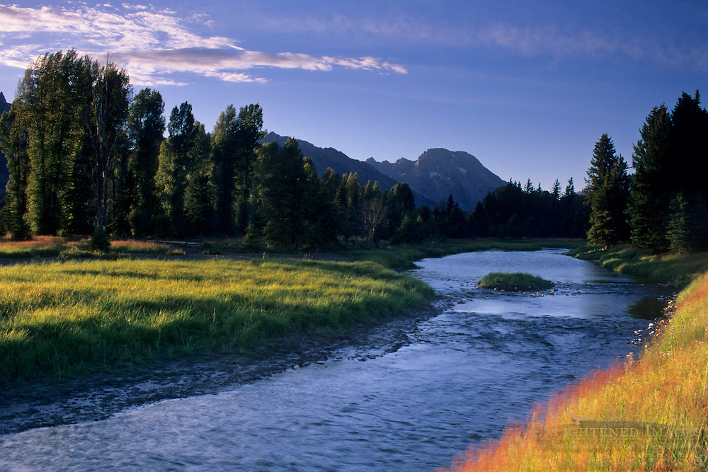 Side channel flow of the Snake River below Mt. Moran at sunset, Grand Teton Nat'l. Pk., WYOMING