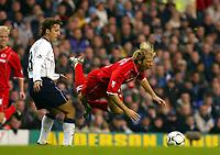 Photograph: Scott Heavey.<br />Tottenham Hotspur v Middlesbrough. FA Barclaycard Premiership. 26/10/2003.<br />Mauricio Taricco sweeps the legs away from Gaizka Mendieta