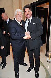 Left to right, DENNIS BASSO and GIORGIO VERONI at a dinner in honour of Dennis Basso in celebration of his new boutique in Harrods held at Claridge's, Brook Street, London on 15th October 2009.