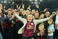 Aston Villa fans celebrate on the pitch after the final whistle. The FA cup, 6th round match, Aston Villa v West Bromwich Albion at Villa Park in Birmingham, Midlands on Saturday 7th March 2015<br /> pic by John Patrick Fletcher, Andrew Orchard sports photography.