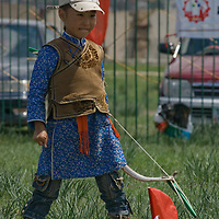 A young archer prepares to compete at a naadam festival in Zuunmod, Mongolia, near Ullanbaator.