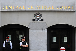 © Licensed to London News Pictures. 23/08/2012. London,UK.Police officers staying in the front of the Central Criminal Court in London.  Photo credit : Thomas Campean/LNP..