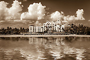 Photo art image of reflections of the Royal Hawaiian hotel on Waikiki Beach in Hawaii