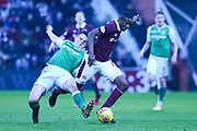 John McGinn tackles Arnoud Djoum during the William Hill Scottish Cup 4th round match between Heart of Midlothian and Hibernian at Tynecastle Stadium, Gorgie, Scotland on 21 January 2018. Photo by Kevin Murray.