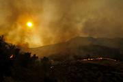 Smoke rises from a wildfire near Placenta Canyon Road in Santa Clarita, Calif., Sunday, July 24, 2016.(AP Photo/Ringo H.W. Chiu)