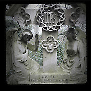Two stone angels on a gravestone