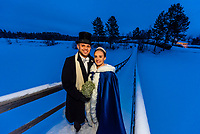 A Norwegian bride and groom stand on a snowy bridge after their winter wedding in Trysil, Norway.