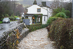 © Licensed to London News Pictures. 20/01/2020. Walsden, UK. Walsden water in West Yorkshire has burst its banks as storm Christoph batters the UK with heavy rain. Photo credit: Ioannis Alexopoulos/LNP