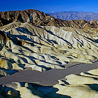 Eroded mineral hills stretch below Zabriskie Point in Death Valley National Park.