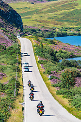 Motorists and bikers on remote highway A894 part of North Coast 500 tourist route, in Highland Region, near Scourie north Scotland in summer,United Kingdom