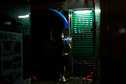 Protester covers surveillance camera by using umbrella during the protest on September 6th, 2029 at Mong Kok in Hong Kong.
