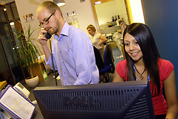 Office Receptionists work at the office reception of a large NHS office