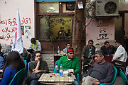 Protesters who have come from a rally in Tahrir Square talk and rest at the Zahrat al-Bustan cafe, Cairo, Egypt