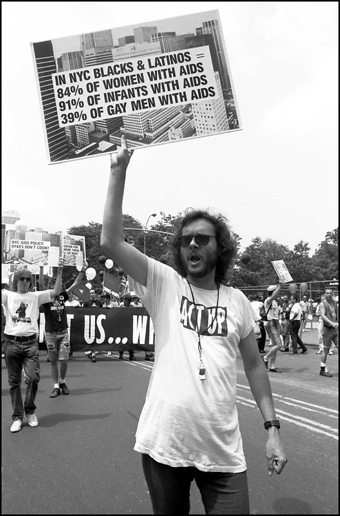 """ACTUP NY, on June 24, 1989, the 20th anniversary of the Stonewall riots, participating in a renegade march up 6th avenue to Central Park. Themed, """"In The Tradition"""", this march followed the same route as the original march 20 years ago and was designed as a rebuke to the corporatization of the gay pride parade."""