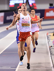 Poland's Marcin Lewandowski crosses the finish line to win the Men's 1500m final during day three of the European Indoor Athletics Championships at the Emirates Arena, Glasgow.