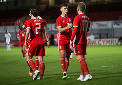 NEWPORT, WALES - Tuesday, October 16, 2018: Wales' Thomas Harris congratulates Connor Evans for his goal during the UEFA Under-21 Championship Italy 2019 Qualifying Group B match between Wales and Switzerland at Rodney Parade. (Pic by Laura Malkin/Propaganda)