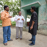 CAPTION: At the site of the proposed plant, Pradhan (leader) of Baharayen Rammurat Yadav (left), discusses plans for electricity provision under the SPEED initiative with Secretary of PANI Bharat Bhushan (centre) and Akash Mittal of TARA (right). LOCATION: Baharayen, Faizabad District, Uttar Pradesh, India. INDIVIDUAL(S) PHOTOGRAPHED: From left to right - Rammurat Yadav, Bharat Bhushan and and Akash Mittal.