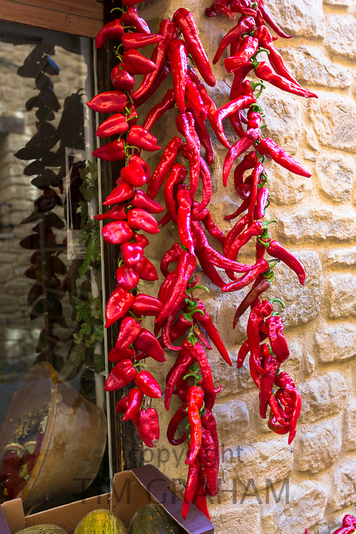 Hot spicy red chilli peppers - chillies -  outside vegetable food shop in Laguardia, Rioja-Alavesa, Spain