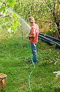 Man waters his garden