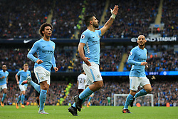 21st October 2017 - Premier League - Manchester City v Burnley - Sergio Aguero of Man City (C) celebrates with teammates Leroy Sane (L) and David Silva (R) after scoring their 1st goal - Photo: Simon Stacpoole / Offside.
