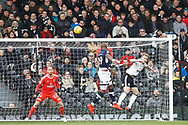 Tom Elliott of Millwall © heads a chance on goal. EFL Skybet football league championship match, Fulham v Millwall at Craven Cottage in London on Saturday 25th November 2017.<br /> pic by Steffan Bowen, Andrew Orchard sports photography.