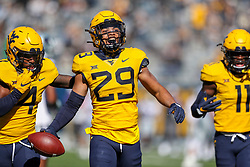 Oct 31, 2020; Morgantown, West Virginia, USA; West Virginia Mountaineers safety Sean Mahone (29) celebrates after intercepting a pass intended for Kansas State Wildcats wide receiver Eric Hommel (18) during the first quarter at Mountaineer Field at Milan Puskar Stadium. Mandatory Credit: Ben Queen-USA TODAY Sports