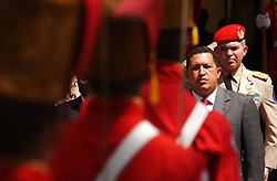 Venezuela President Hugo Chavez stands for the Venezuelan national anthem before a bilateral meeting  with  Robert G. Mugabe of Zimbabwe at the Miraflores Presidential Palace in Caracas, Venezuela on Thursday February 26, 2004.  The meeting is part of the G15 summit being held in Caracas.