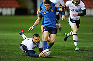 France's Anthony Belleau  tackled by Scotland's Tom Galbraith during the U20 Six Nations match between Scotland U20's and France U20's at Broadwood Stadium, Cumbernauld, Scotland on March 11th  2016.   AFP PHOTO / NEIL HANNA