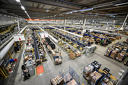 Embargoed to 0001 Friday November 16 One of the huge packing areas at Amazon's fulfillment centre in Swansea, in the run up to Black Friday.