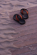 Newport, RI. - Flip flops left on the beach board walk at the edge of the sand