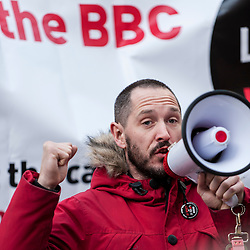 "© Licensed to London News Pictures. 23/11/2015. LONDON, UK. Actor, Bertie Carvel, addresses fans of Doctor Who known as ""Whovians"" and other supporters of the BBC gathered outside Broadcasting House in central London to oppose the threat of 20% government cuts to the Corporation which has brought shows such as Dr Who since 1922. Photo credit : Stephen Chung/LNP"