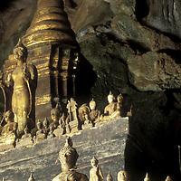Asia, Laos, Ban Pak Ou, Thousands of statues of Buddha fill lower entrance to Pak Ou Caves along Mekong River