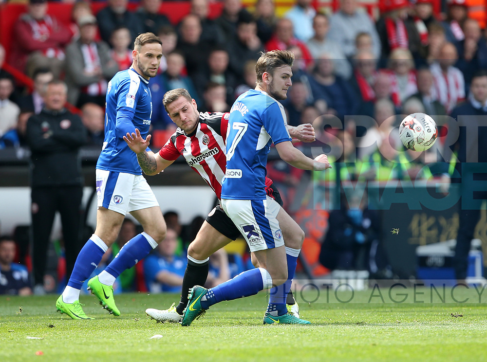 Sheffield United's Billy Sharp tussles with Chesterfield's Laurence Maguire during the League One match at Bramall Lane, Sheffield. Picture date: April 30th, 2017. Pic David Klein/Sportimage