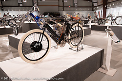 "1908 Indian Twin ""Torpedo Tank"" 61 cubic inch board track racer from the Jill and John Parham Collection at the National Motorcycle Museum on view in the What's the Skinny Exhibition (2019 iteration of the Motorcycles as Art annual series) at the Sturgis Buffalo Chip during the Sturgis Black Hills Motorcycle Rally. SD, USA. Friday, August 9, 2019. Photography ©2019 Michael Lichter."