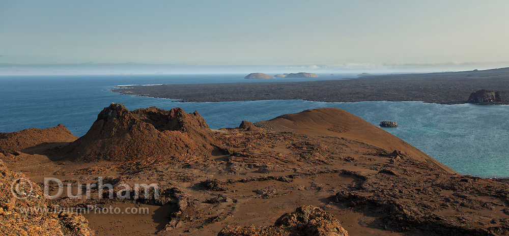 A cinder cone dominates the harsh volcanic landscape of Bartolome island, one of the younger islands in the Galapagos Archipelago, Ecuador.