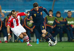 Claudio Morel of Paraguay vs Fernando Torres of Spain during the  2010 FIFA World Cup South Africa Quarter Finals football match between Paraguay and Spain on July 03, 2010 at Ellis Park Stadium in Johannesburg. (Photo by Vid Ponikvar / Sportida)
