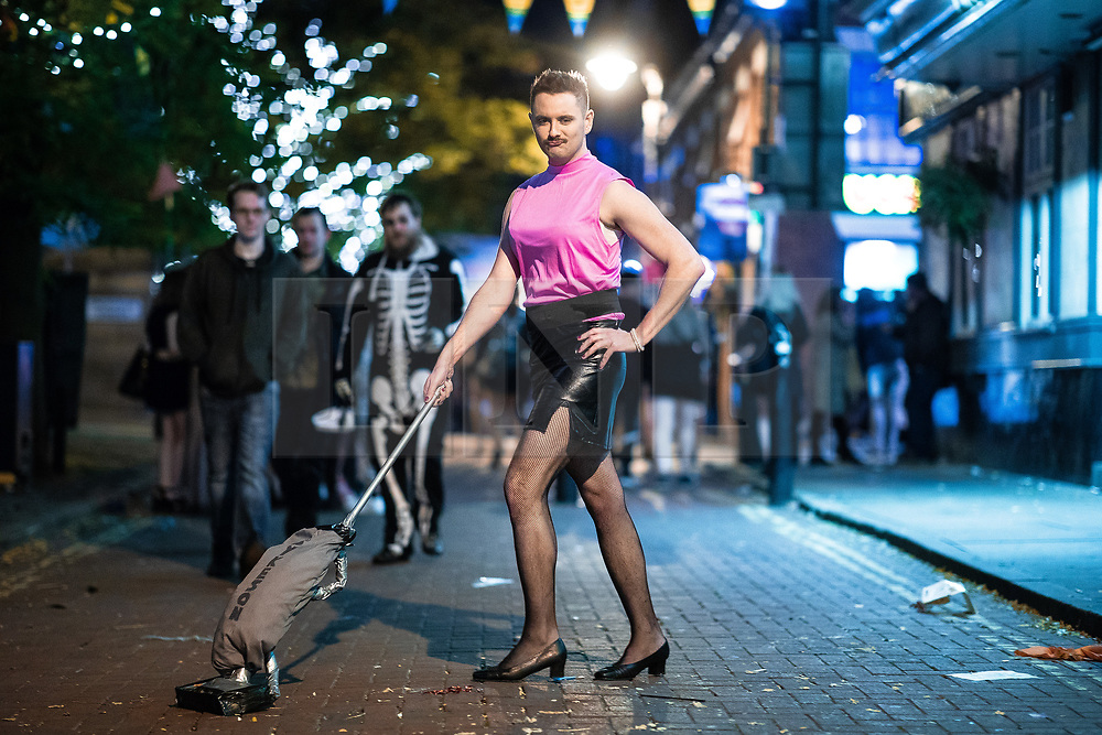 """© Licensed to London News Pictures . 28/10/2018. Manchester, UK. A man dressed as Freddie Mercury performing in the video to Queen's """" I want to break free """" on Canal Street in Manchester City Centre . Revellers on a night out , many in fancy dress , on the weekend before Halloween . Photo credit: Joel Goodman/LNP"""
