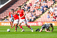 Kieffer Moore of Barnsley (19) and Alex Mowatt of Barnsley (27) in action during the EFL Sky Bet League 1 match between Barnsley and Shrewsbury Town at Oakwell, Barnsley, England on 19 April 2019.