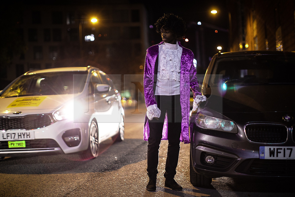© Licensed to London News Pictures . 27/10/2018. Manchester, UK. A man dressed as Prince on Princess Street . Revellers on a night out , many in fancy dress , on the weekend before Halloween . Photo credit: Joel Goodman/LNP