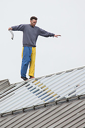 © Licensed to London News Pictures . 14/09/2015. Manchester, UK. STUART HORNER on the roof at HMP Manchester (formerly Strangeways Prison ) , where Horner is conducting a rooftop protest against prison conditions . Photo credit : Joel Goodman/LNP