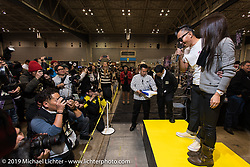 Kiyo Mitsuhiro Kiyonaga gets introduced to the crowd at the Annual Mooneyes Yokohama Hot Rod and Custom Show. Japan. Sunday, December 7, 2014. Photograph ©2014 Michael Lichter.