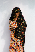 Shy young girl modestly dressed in Muscat in Oman, Middle East