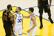 Golden State Warriors guard Stephen Curry (30) and Cleveland Cavaliers forward LeBron James (23) have a heated exchange during Game 1 of the NBA Finals at Oracle Arena in Oakland, Calif., on May 31, 2018. (Stan Olszewski/Special to S.F. Examiner)